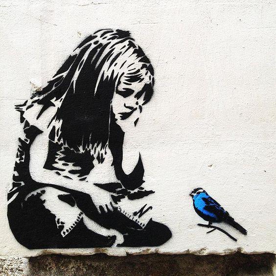 Banksy Girl with blue bird Graffiti – Street Art