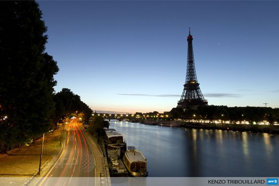 FRANCE, Paris: A picture taken on August 10, 2013 shows the Eiffel Tower in Paris. AFP PHOTO / KENZO TRIBOUILLARD