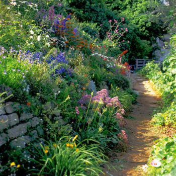The Materials That Create English Gardens of Mystery.Winding pathways surrounded by flourishing plant life