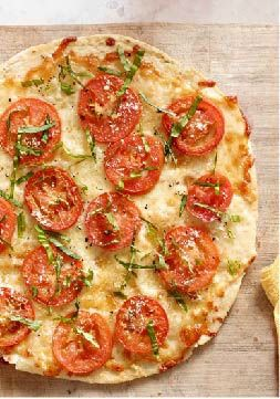 Tortilla Pizza Margherita -- Love the aroma of basil and garlic in the kitchen? Our homemade margherita pizza is an easy weeknight recipe when you make it with a flour tortilla.