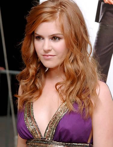 red and blonde ombre hair | Isla Fisher's strawberry blonde highlights.