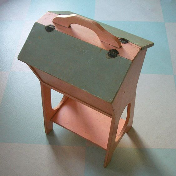 old angle top sewing box........put some chalk on the angled part & fill it with art supplies.