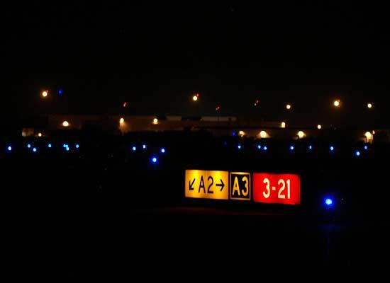 Airport signs at night taxiway