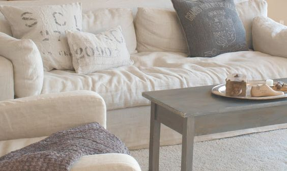 Belgian linen sofa with pillows/vintage bench used as coffee table/Hello Lovely Studio