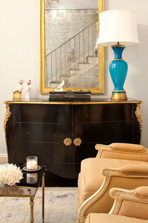living rooms - antique black chest cabinet blue lamp gold gilt mirror gray rug antique mirrored nesting tables  Katie Lee's Home  Lovely vignette