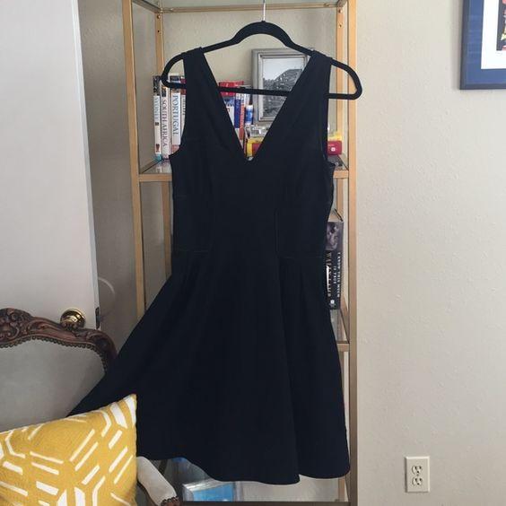 Black DVF dress Black full skirt fitted waist DVF dress. Hidden pockets Diane von Furstenberg Dresses