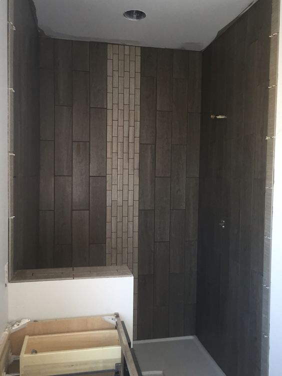Wood plank shower with mosaic center stripe
