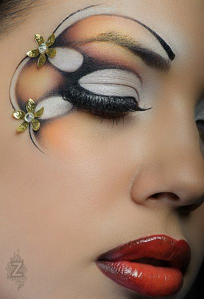 Artistic white, brown and orange swirls and circles with crystal accented flowers by MUA Antonina Zozulya: