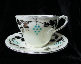 Exquisite Paragon Enamel Grapes and Silver Overlay Leaves Cup and Saucer