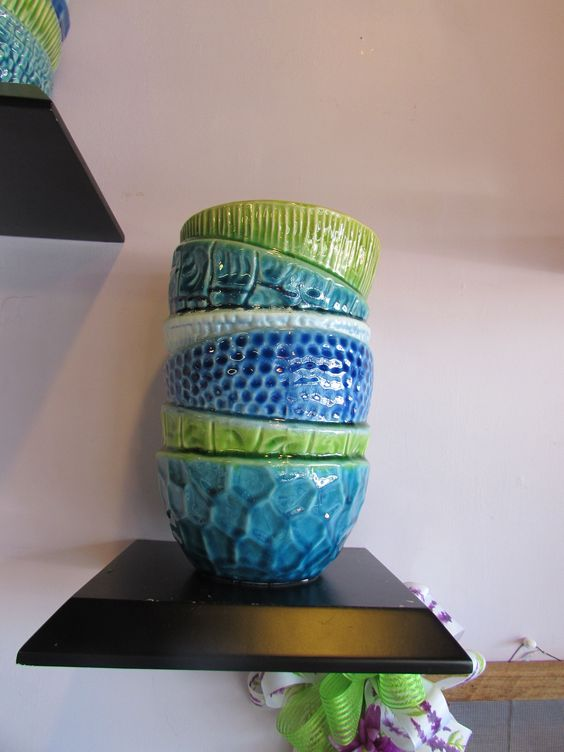 This brand new vase we got in is just too cute! It looks like stacked bowls! We have this small size and a large size!