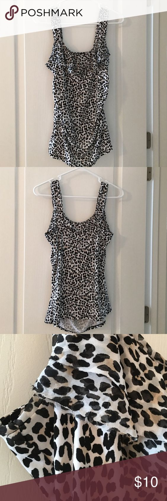 Leopard tank Ruffle neckline, slight gathering on sides to make front have a little extra fabric around tummy so it has a ruching ( sp?) look, straight back, good condition, only issue is wear on ruffle under the arms as pictured. Very close to the body fit, even in the front. Would look great with the black pants I have listed! White House Black Market Tops Tank Tops