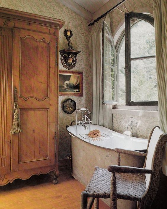The picture of South of France elegance and effortless charm in this enchanting #FrenchCountry bathroom with antiques.