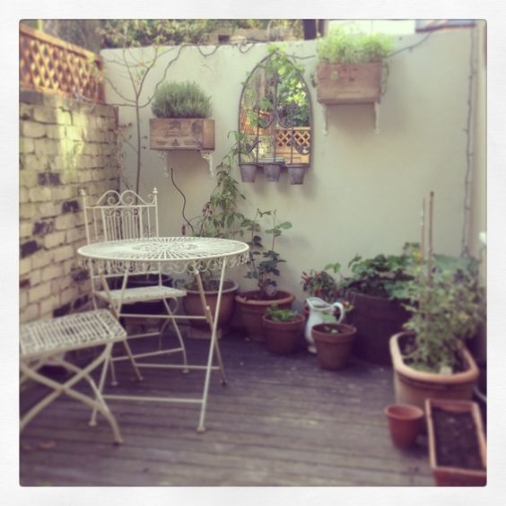 City garden- Wine boxes filled with herbs attached to the wall using brackets...great way to save space!!