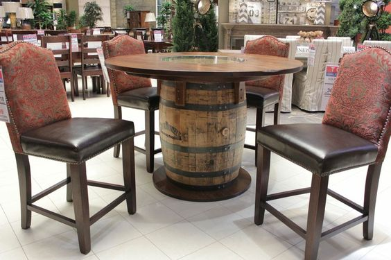 Bring the uniquely American charm of the Jack Daniel's distillery home to Texas with this pub table constructed from an authentic aging barrel. Set it up in your game room or man cave! | Houston TX | Gallery Furniture |