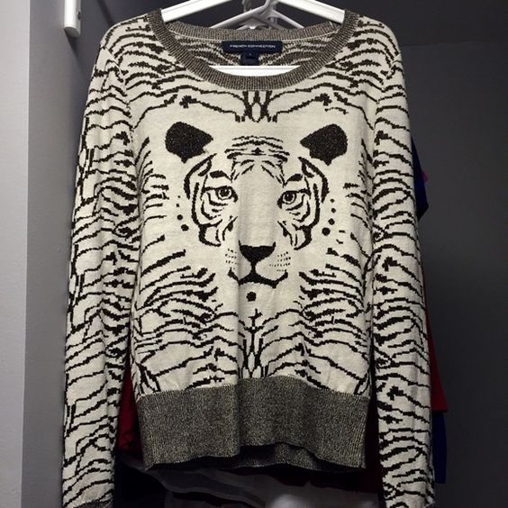 French Connection Lion sweater French connection lion sweater. Cream sweater with brown and gold lion and stripe knitting throughout. Gold sparkles. Excellent condition with no notes stains, holes or pulls. Size large but runs a little small French Connection Sweaters Crew & Scoop Necks