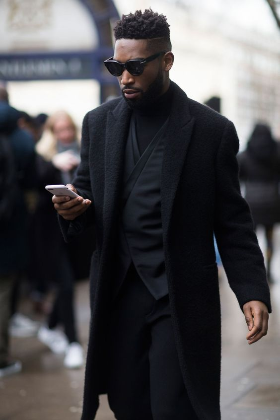Tinie Tempah looks sleek in dark hues as he enters the Topman Design show on Friday. .January 2016.