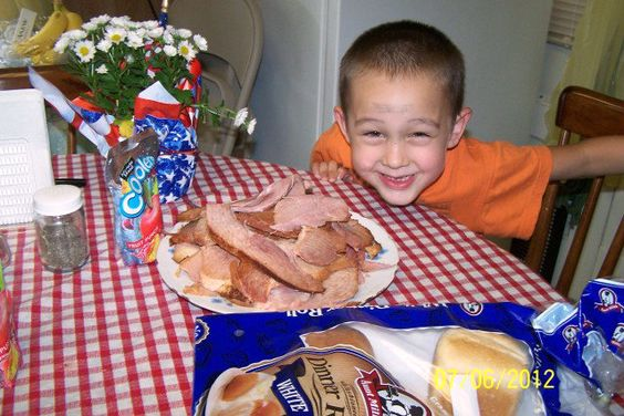 Youngest grandson admiring the ham we are about to have for lunch.