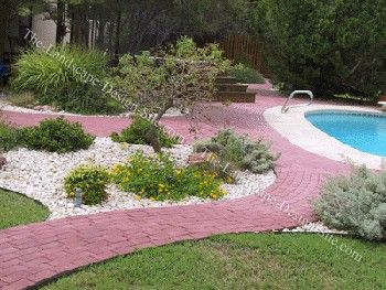 Flower bed planting ideas for around a swimming pool for Flowers around swimming pool