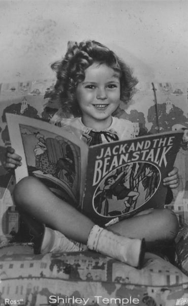 Shirley Temple reading 'Jack and the Beanstalk'.