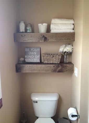 Those shelves above toilet are so pretty or maybe handsome would be a better word. I might put more shelves in other areas besides bathroom.: