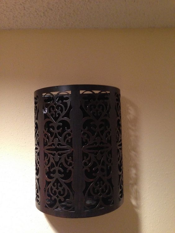 Turned a wall light sconce into my new doorbell chime cover