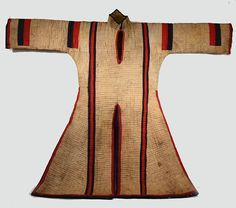 A quilted Jibbah made for horseback riding  Sudan Section: African Materials: Cotton Description: Quilted coat. Fighting man's. White cotton with bands of red and black. Length: 106cm Width: 88cm