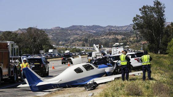 Plane slams into car parked on shoulder of freeway; car passenger killed