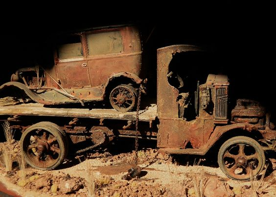 Rusted out Mack AC flat bed with Ford model T sedan