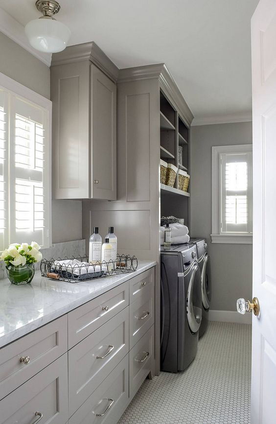 Laundry room. Front loading washer dryer, storage baskets for laundry detergent…:
