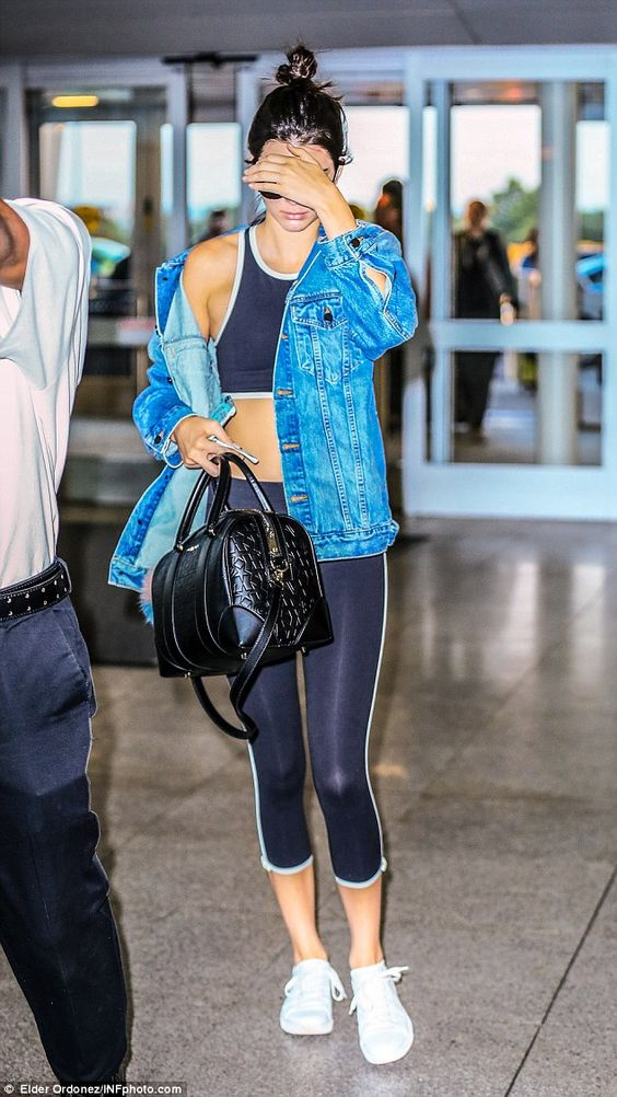 Dressed down: Kendall Jenner, 19, ensured she was comfy for her flight from New York's JFK...
