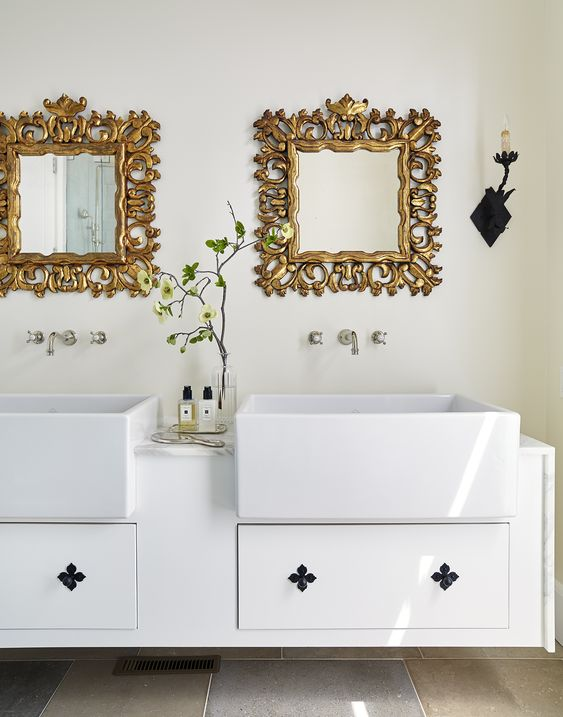Beautiful white bathroom with rectangular inward sink with elaborate gold detailed mirrors | Amy Meier Design