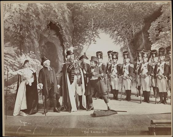 """Byron Company onstage photograph of the authorized American production of """"The Emerald Isle,"""" Principals left to right: Amelia Fields as the Countess of Newton, F. Stuart Hyatt as Doctor Fiddle D. D., Charles Dunngan as the Earl of Newton and Jefferson de Angelis as Professor Bunn. Produced by Sam S. Shubert at the Herald Square Theatre on Broadway, New York, 1902."""