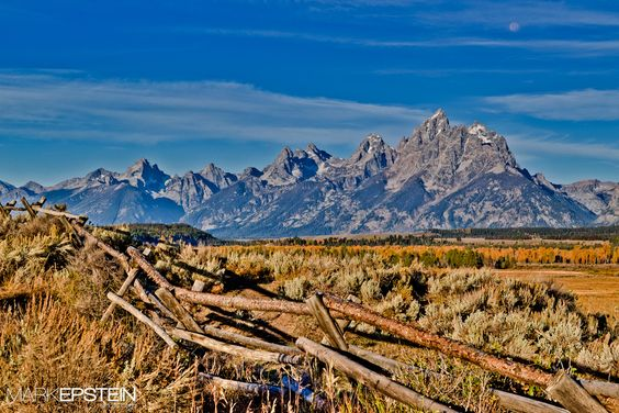 Down the Old Buck Rail    The full moon sets on the Tetons as a new day begins.