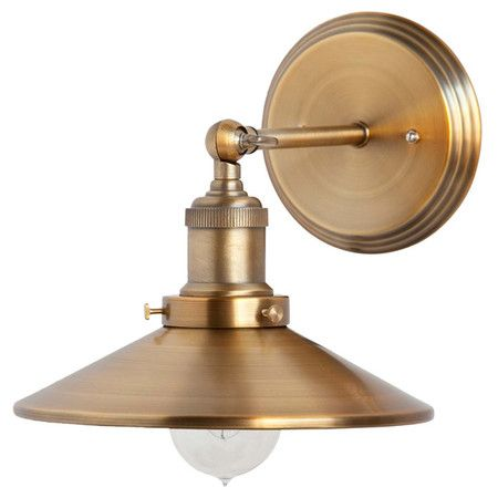 Cast a warm glow in your library or master suite with this industrial-chic wall sconce, featuring a gold finish and midcentury-inspired silhouette.