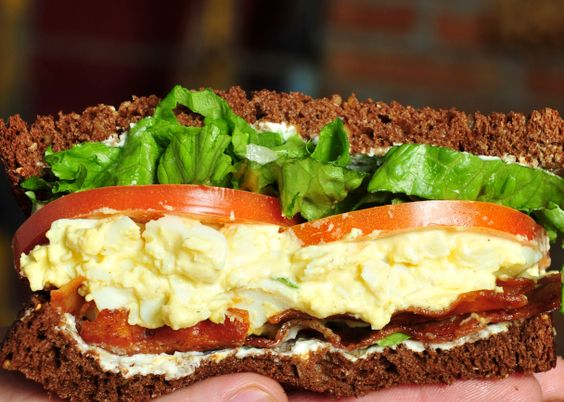 High Baggin's sandwich  Homemade egg salad, lettuce, tomato, bacon, cream cheese on 12 grain bread.