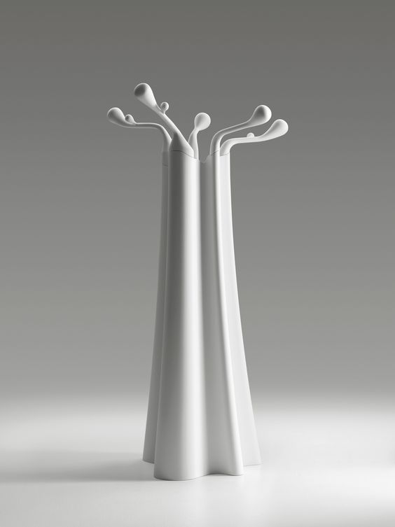 Baobab by MDF Italia. Coat hanger with an undulated trunk and a crown of irregular branches.  Mould in Cristalplant® (a composite material made up of natural minerals and polyester and acrylic polymers) in matt white.  Available at Essess Designer FABBRICA showroom. www.essessltd.com
