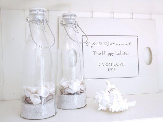 Zand en schelpen in een fles leuk als decoratie in de for Decoratie zomer