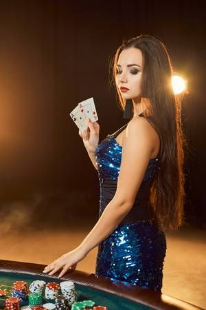 Young beautiful woman poses near poker table in luxury casino... | Casino,  Poker, Young and beautiful