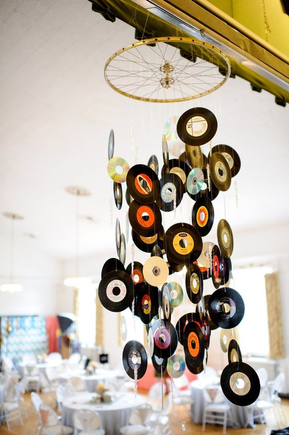 Mobile or chandalier made from records and a bike wheel..this requires putting it all together..what a payoff though.