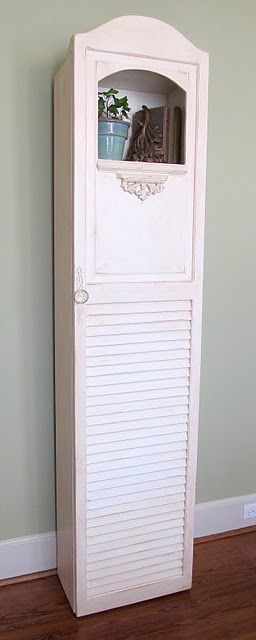 great use for old bifold doors..cover a tall slim bookcase to create covered storage