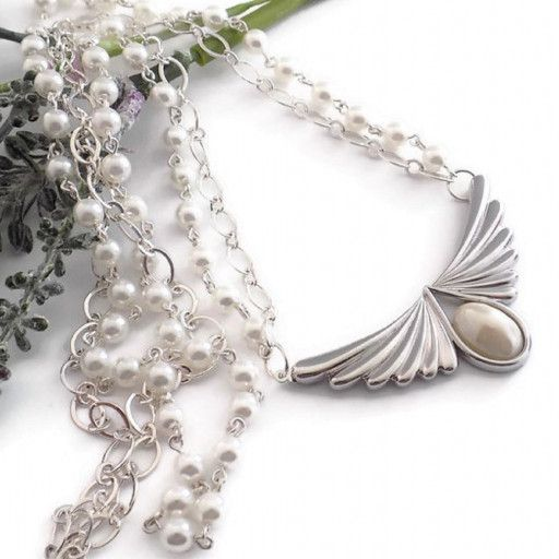 This exquisite Victorian Style white pearl multi strand necklace has a strand of white pearls and a strand of silver chain. The focal point of this feminine necklace is an angel wing clasp. Such an exquisite and romantic necklace for Mom on Mother's Day. Perfect gift for a birthday in June. June's birthstone is a pearl.*This romantic pearl necklace has a silver-plated angel wings clasp with white Swarovski pearl. This clasp features bright silver angel wings with a domed oval Swarovski pearl