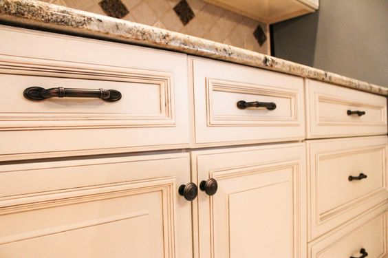 Off white cabinets wells and knobs and pulls on pinterest for Bronze hardware for kitchen cabinets