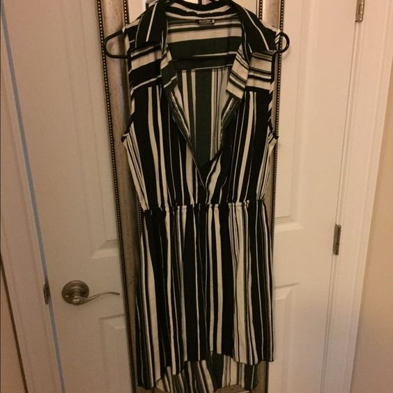 NWOT Striped dress NWOT striped dress. Never worn. sleeveless tunic/dress. cute with a belt and wedges or heels! Very soft material 💟PM ONLY, NO TRADES, NO HOLDS, BUNDLE ITEMS AND SAVE💟 Dresses