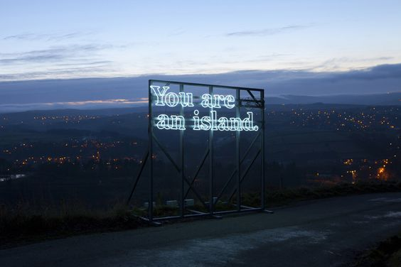 "you are on an island - a neon light project by alicia eggert + mike fleming... ""on"" is blinking"