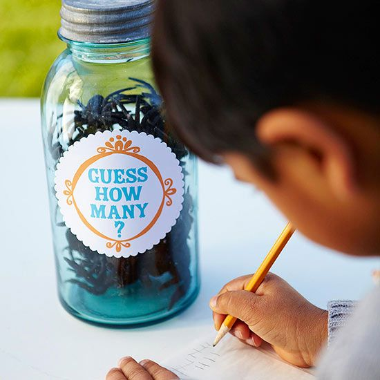 """Add a """"Guess How Many"""" jar for the kids table... for the kids to guess while mom and dad check in. :) Maybe one for the parents too. :)"""