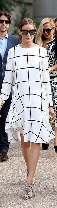 Olivia Palermo wearing Westward Leaning black sunglasses and chloe white print dress