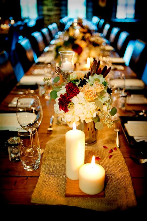 Possible Table Style - like the candles with varied heights and the little block of wood underneath