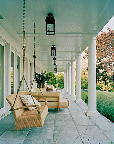 "Shady Southern porch with ""haint blue"" ceiling - a popular tradition that protects the home from bugs as well as evil spirits known as ""haints""."