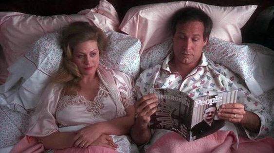 In National Lampoons Christmas Vacation (1989) Clark (Chevy Chase) is reading a People Magazine in bed with Executive Producer of the film Matty Simmons on the cover.