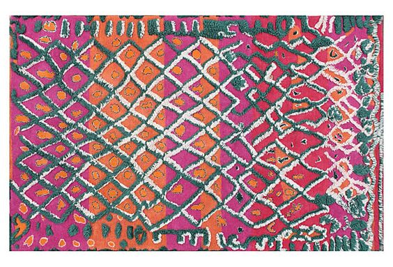 A modern reinterpretation of traditional Moroccan floor-coverings, this handmade rug has a geometric design and a plush half-inch pile. Bright hues enhance the rug, adding playful pops of color.